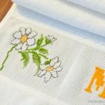 Geburtstagsblumen mal anders: Muttis besticktes Handtuch