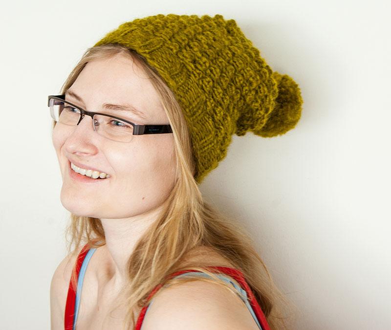 Grüne Bommel-Mütze